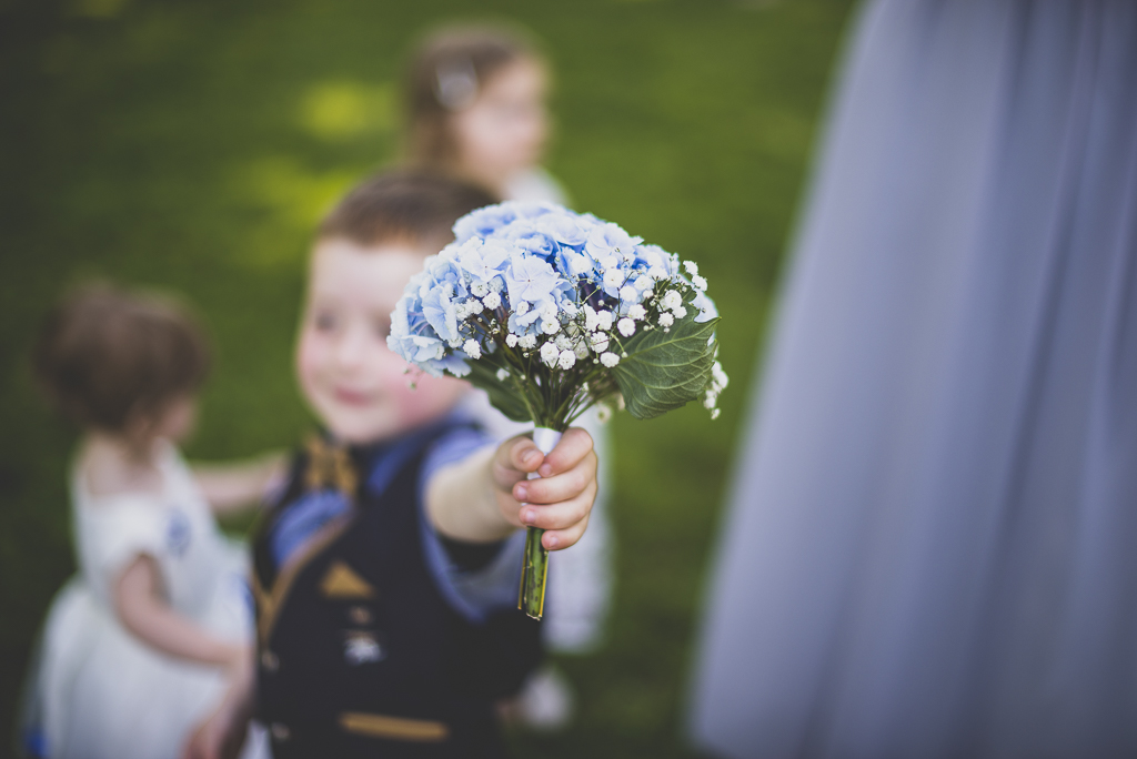 Wedding Photography French château - bouquet held by child - Wedding Photographer