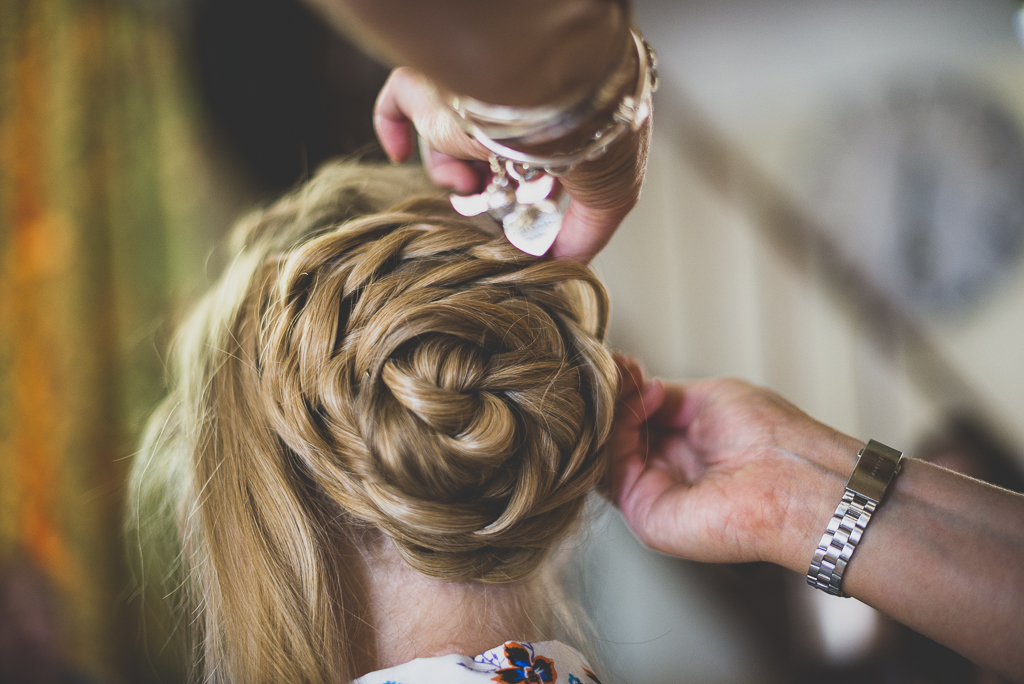 Wedding Photography French château - bride's hair being done - Wedding Photographer
