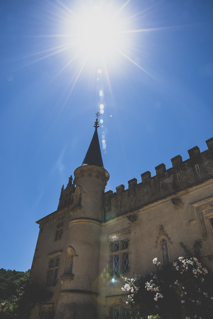 Wedding Photography French château - tower of château and sun - Wedding Photographer