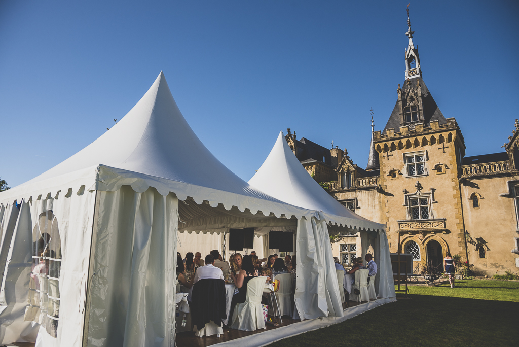 Wedding Photography French château - dinner under marquee - Wedding Photographer