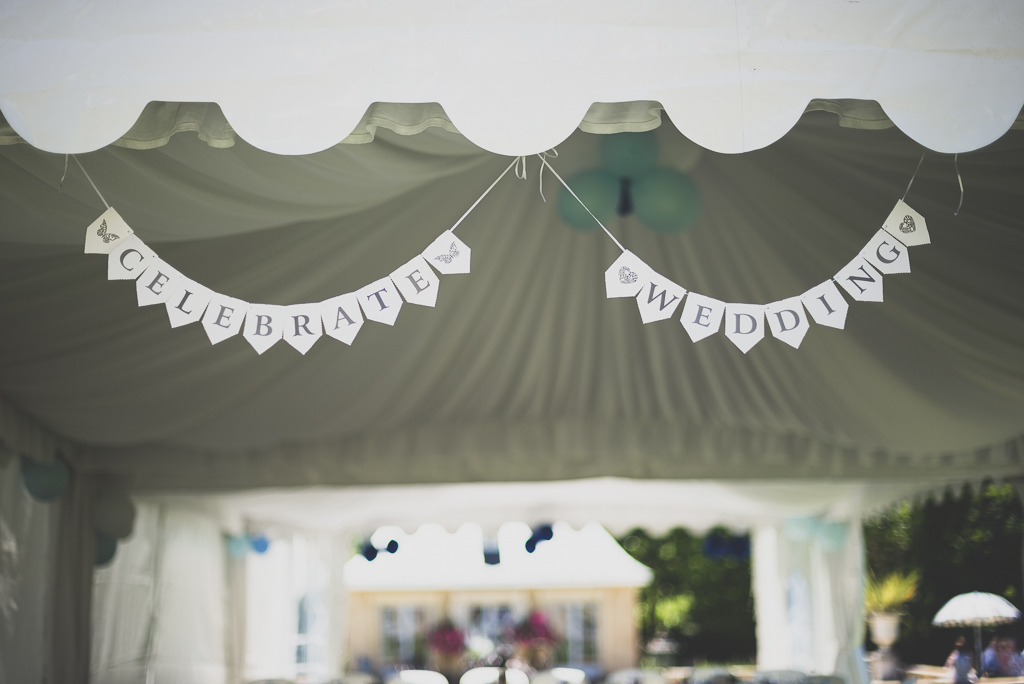 Wedding Photography French château - paper garland on marquee - Wedding Photographer