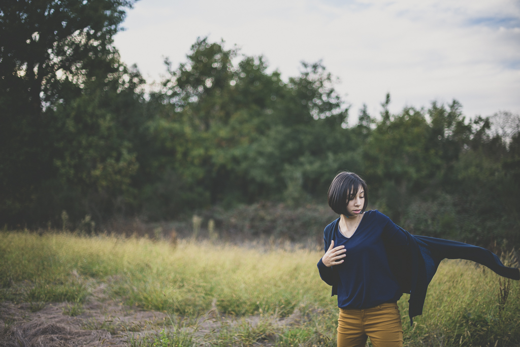 Outdoor family session - girl putting on cardigan - Family Photographer