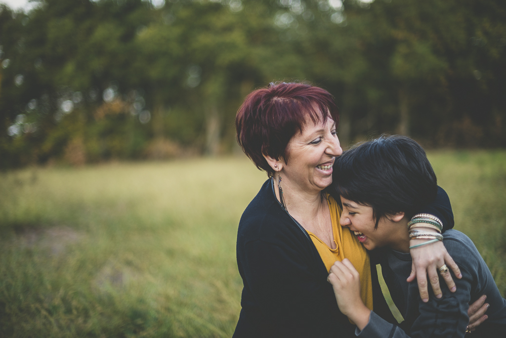 Outdoor family session - boy laughing in his mum's arms - Family Photographer
