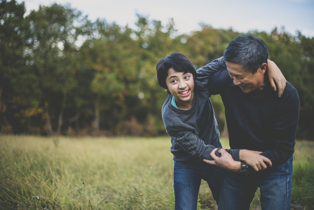 Outdoor family session - boy playing with his dad - Family Photographer