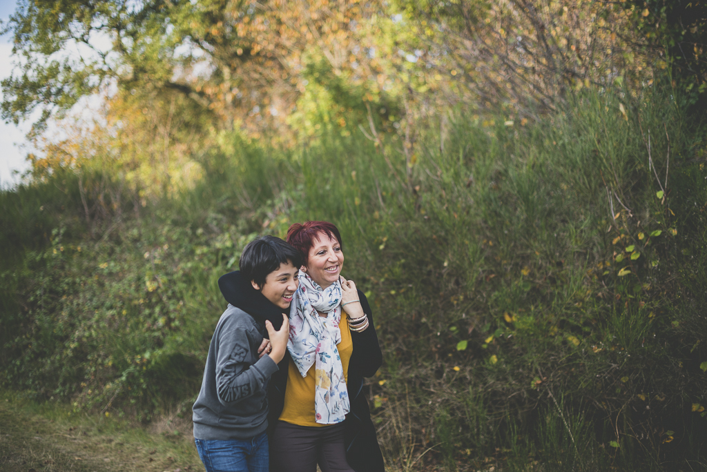Outdoor family session - boy and his mum walking and laughing - Family Photographer
