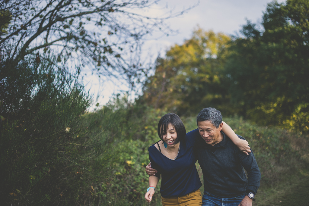 Outdoor family session - girl and her dad walking and laughing - Family Photographer