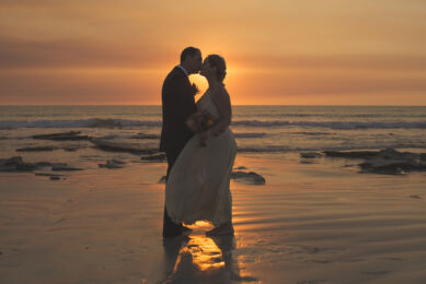 rozimages - wedding photography - bride and groom kissing on the beach in front of sunset - Broome, Australia