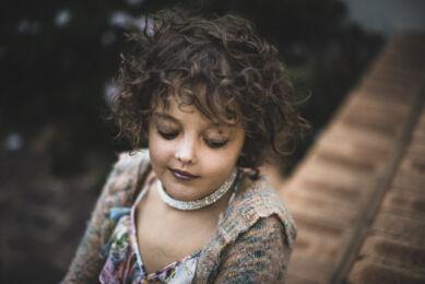 Portrait of girl looking down. Children photographer