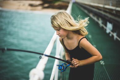 rozimages - portrait photography - family session - girl fishing on jetty - Broome, Australia